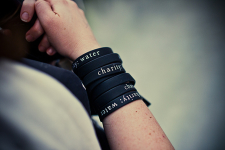 Charity: Water is a great example of a Nonprofit that uses Charity Bracelets effectively! (Photo by Silicone Prairie News / Flickr)