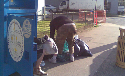 Collecting Cloth Donations from a Donation Box. Learn some Donation Box success tips. (Photo by Random Flotsam / Flickr)