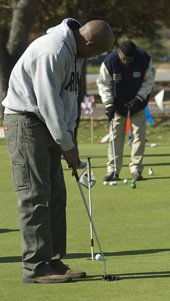 Golf Putting - Golf Fundraising ideas for a Golf Day. (Photo by Fort Meade / Flickr)